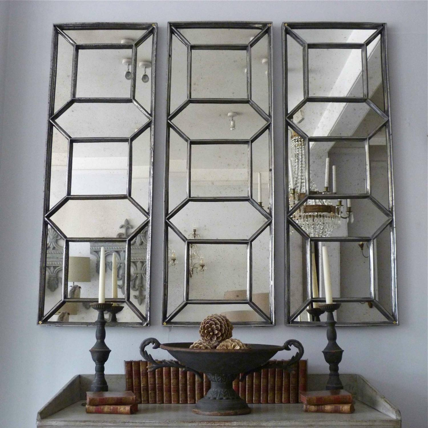 TRIO OF POLISHED CAST IRON ARCHITECTURAL PANEL MIRRORS