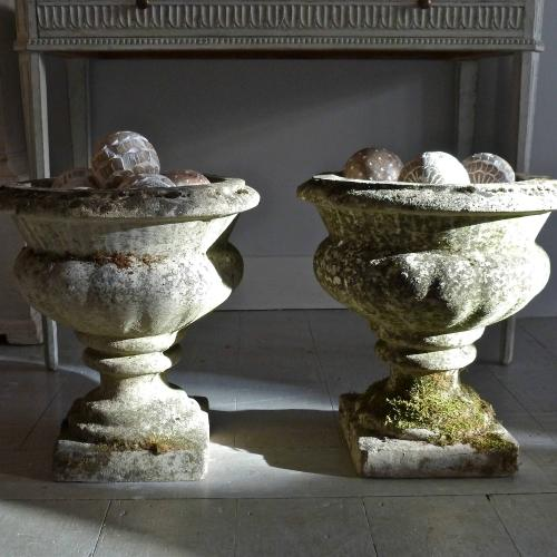 PAIR OF URNS WITH WEATHERED PATINA
