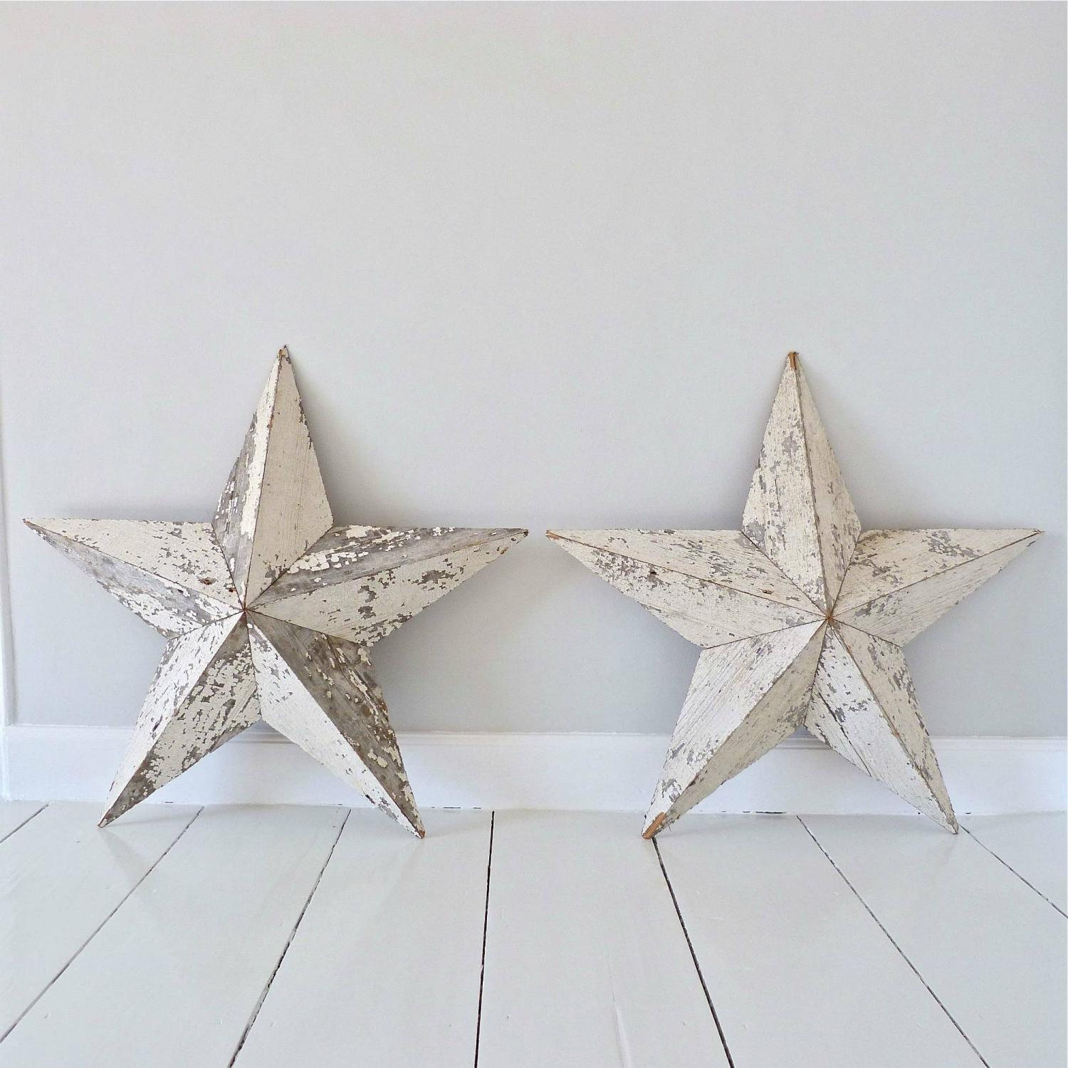 PAIR OF LARGE WOODEN STARS WITH OLD PAINT