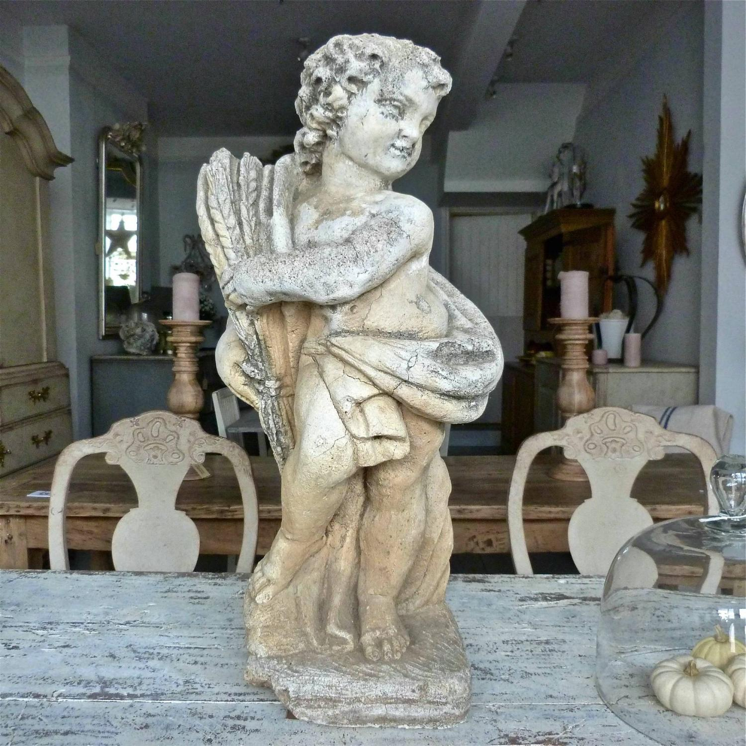 RARE 19TH CENTURY CARVED STONE PUTTO STATUE