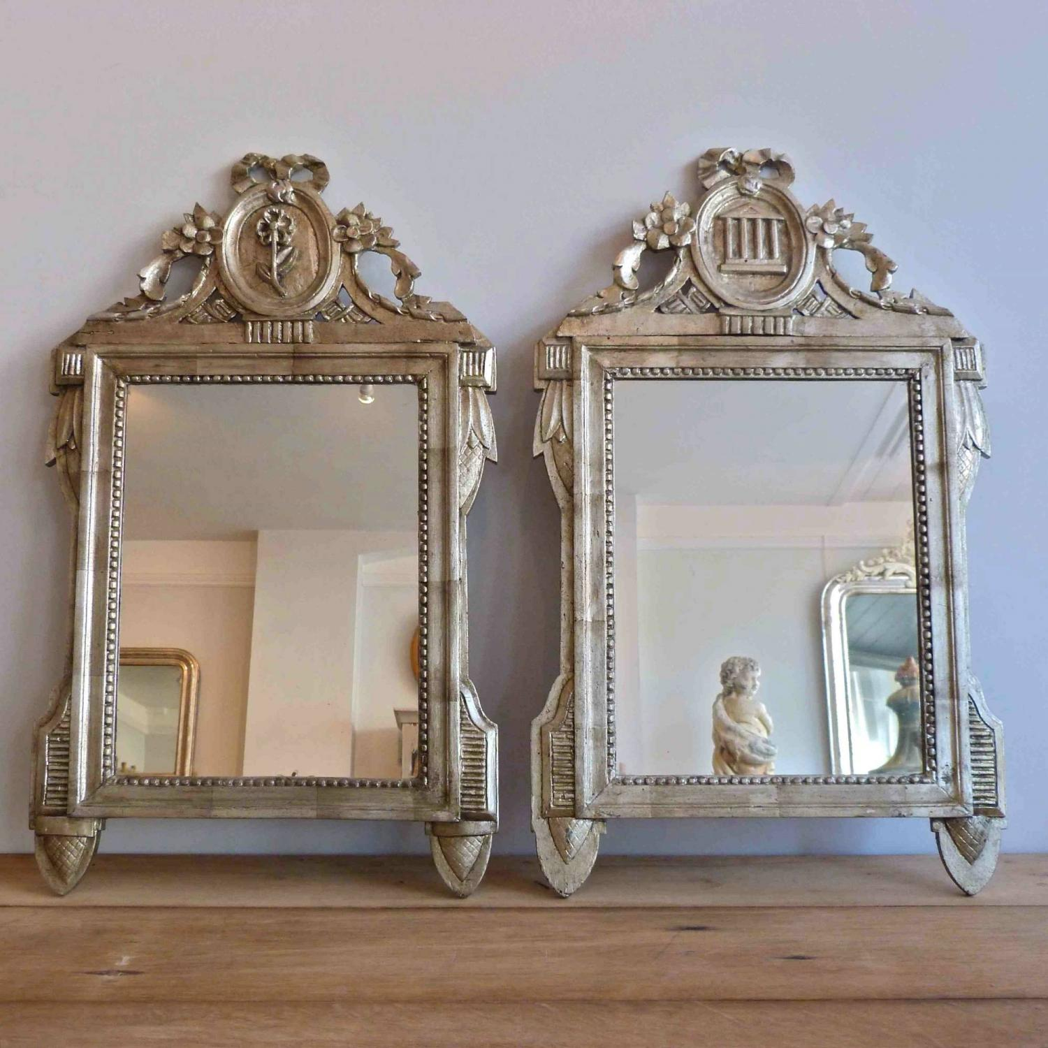 HARLEQUIN PAIR OF DECORATIVE SILVER GILT ITALIAN MIRRORS
