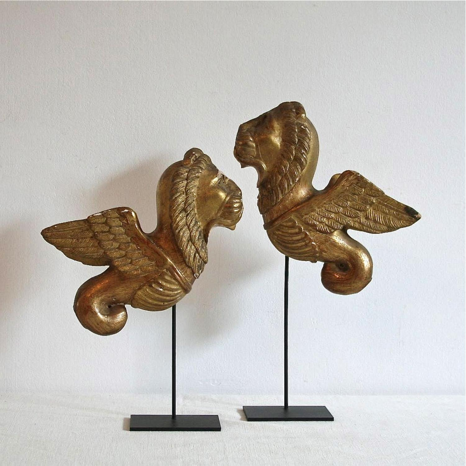 PAIR OF HAND CARVED MYTHOLOGICAL CREATURES