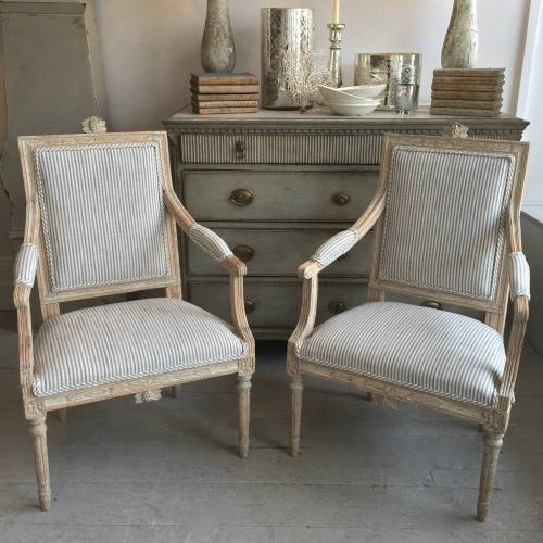 EXCEPTIONAL PAIR OF GUSTAVIAN ARMCHAIRS