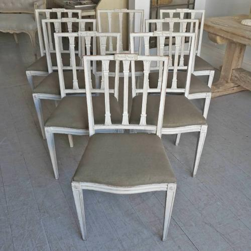 SET OF EIGHT RICHLY CARVED GUSTAVIAN STYLE DINING CHAIRS