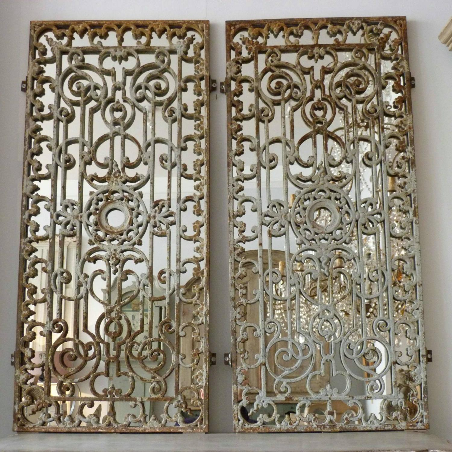 PAIR OF FRENCH 19TH CENTURY DECORATIVE IRON GRILL MIRRORS