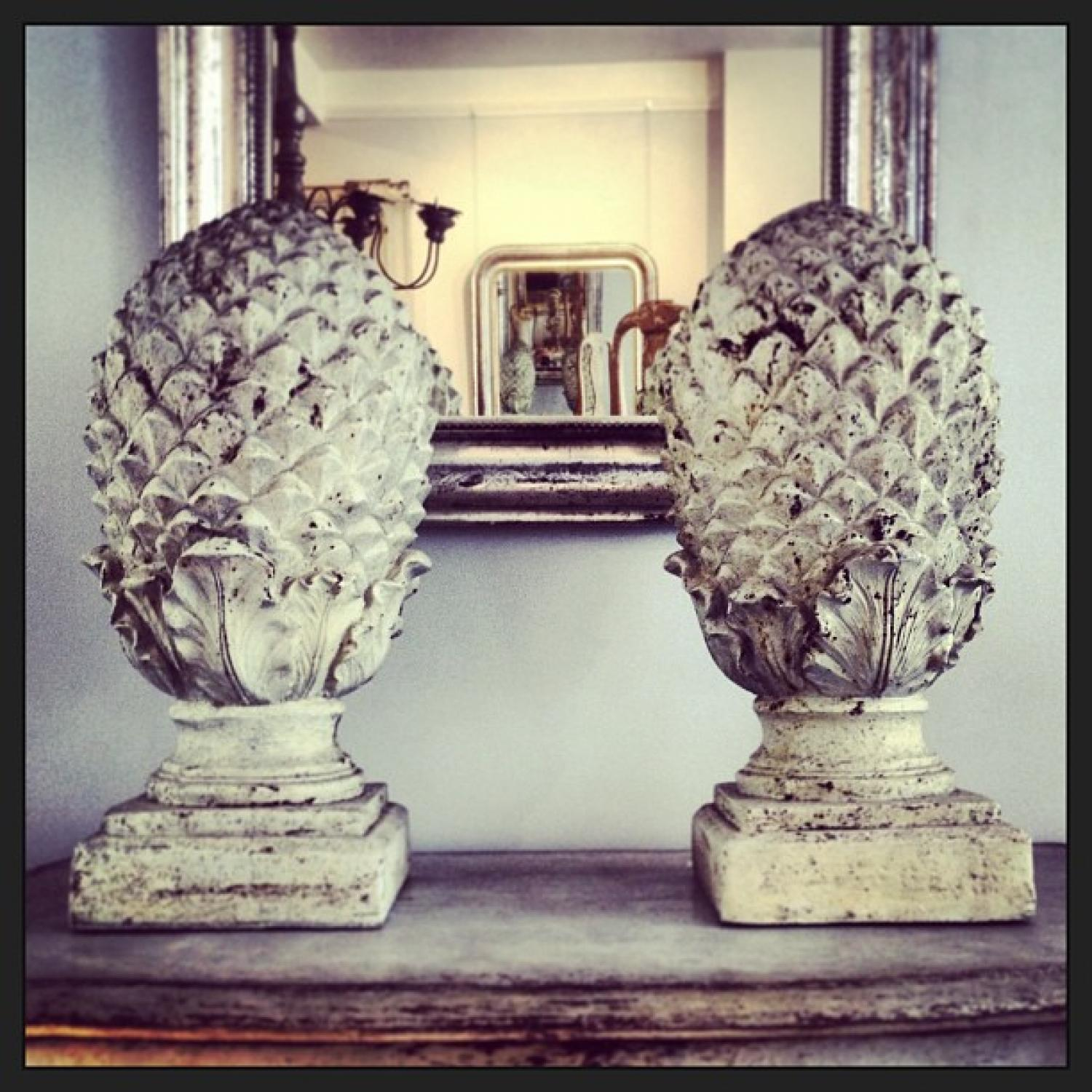 PAIR OF COMPOSITE STONE PINEAPPLES