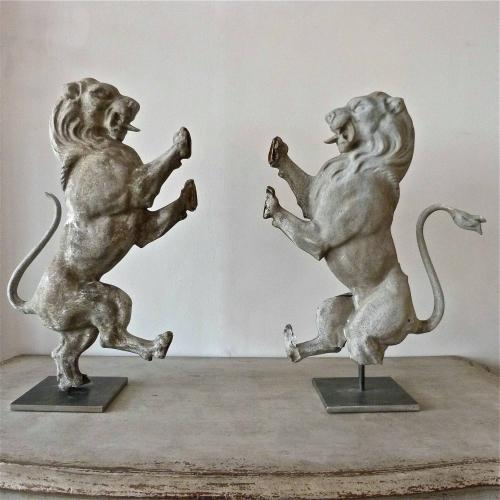 PAIR OF 19TH CENTURY DECORATIVE ZINC LIONS