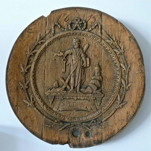 SAINT PETRUS CARVED OAK ROUNDEL DATED 1615