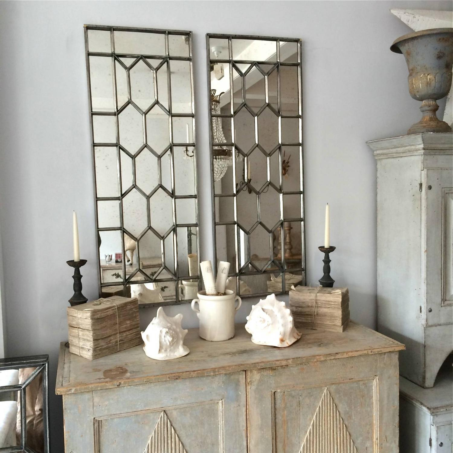 PAIR OF VICTORIAN POLISHED CAST IRON WINDOW MIRRORS