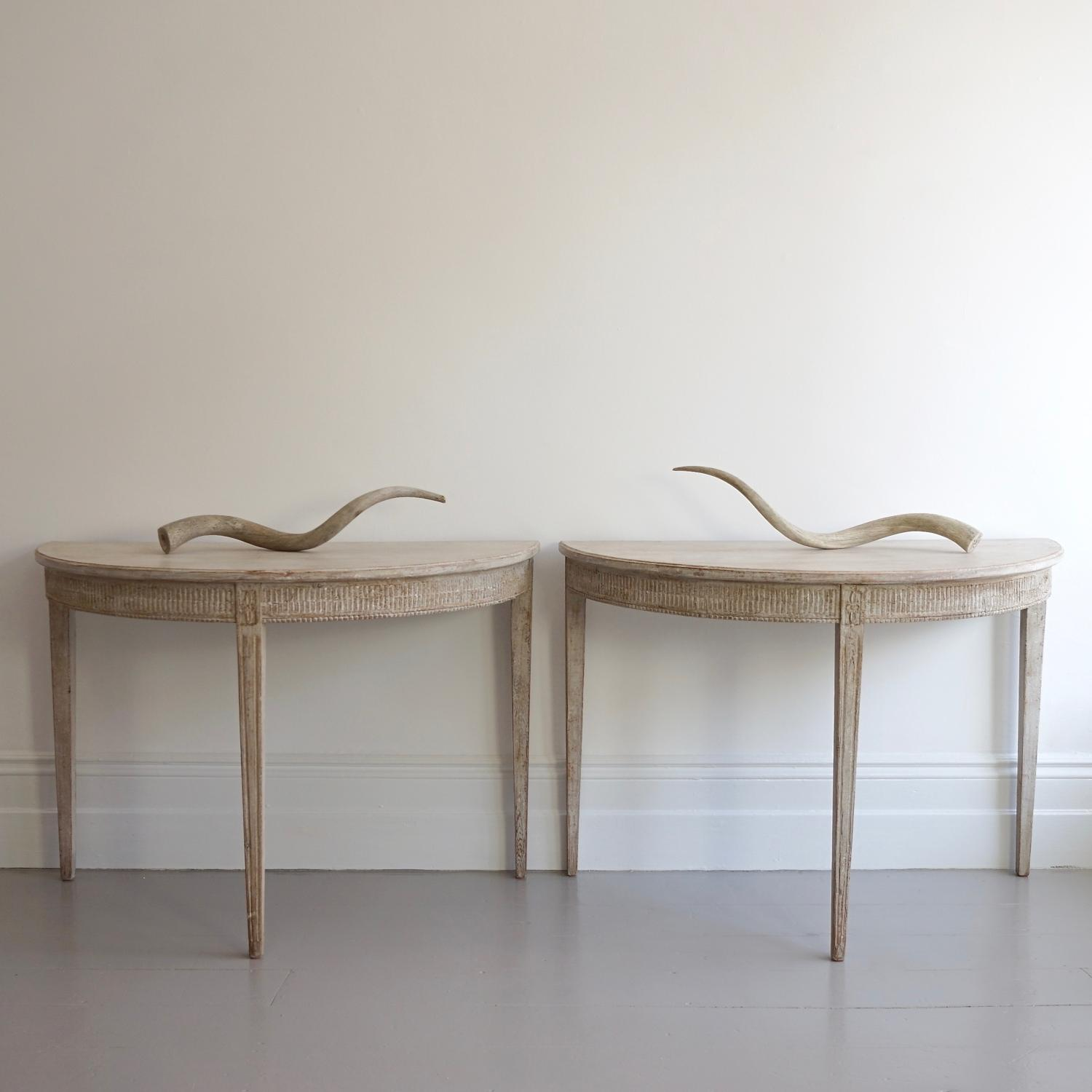PAIR OF RICHLY CARVED GUSTAVIAN DEMILUNES