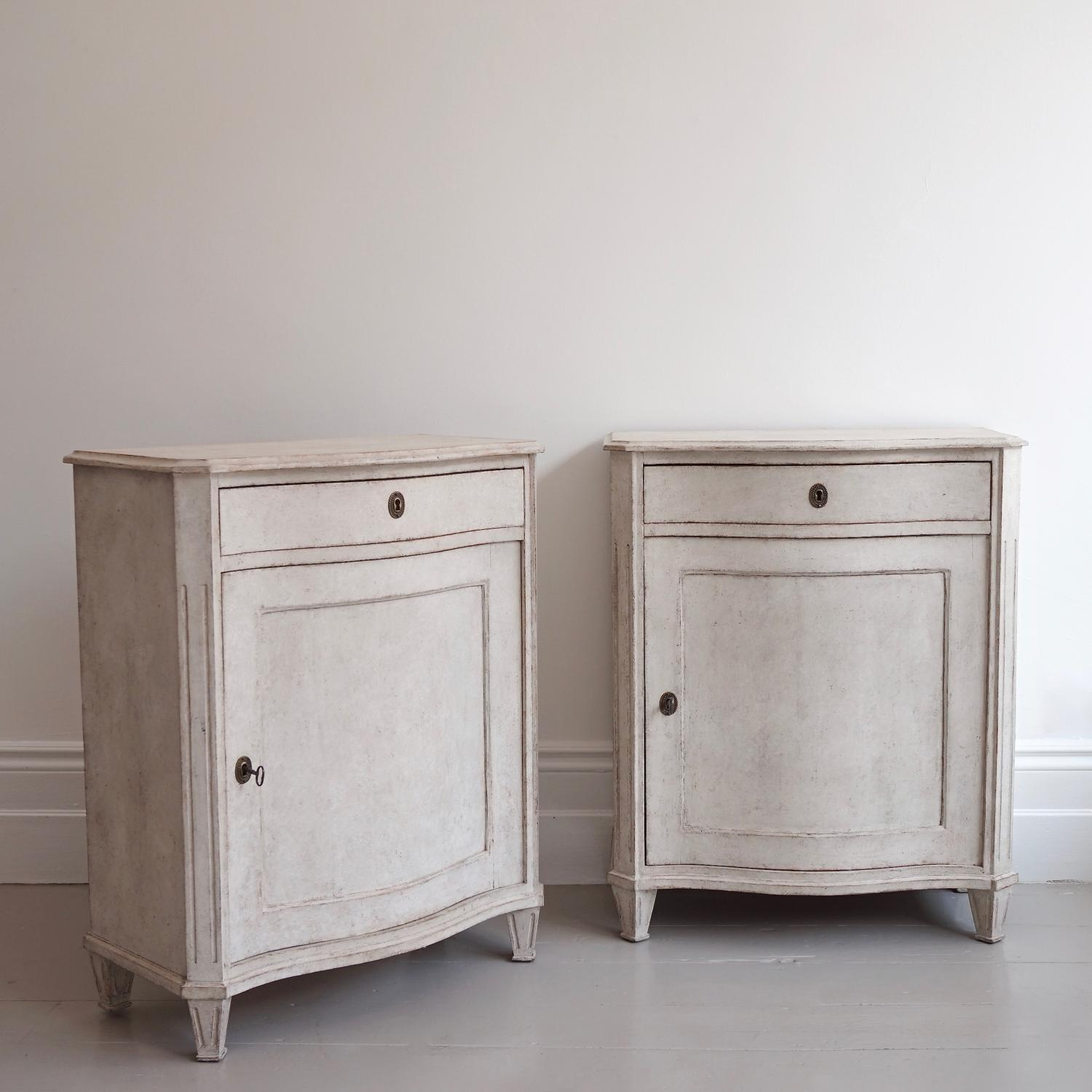 PAIR OF RARE SWEDISH SERPENTINE BEDSIDE CABINETS