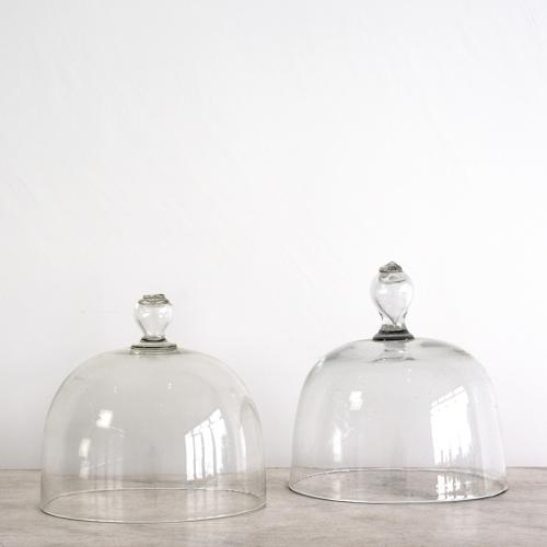 TWO FRENCH GLASS CLOCHES WITH FLOWER DECORATED HANDLES