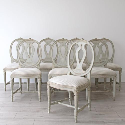 EIGHT GUSTAVIAN ROSE CHAIRS