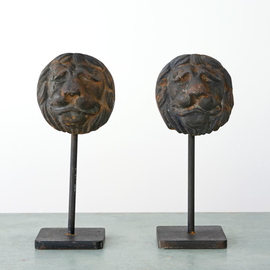 PAIR OF CAST IRON LIONS
