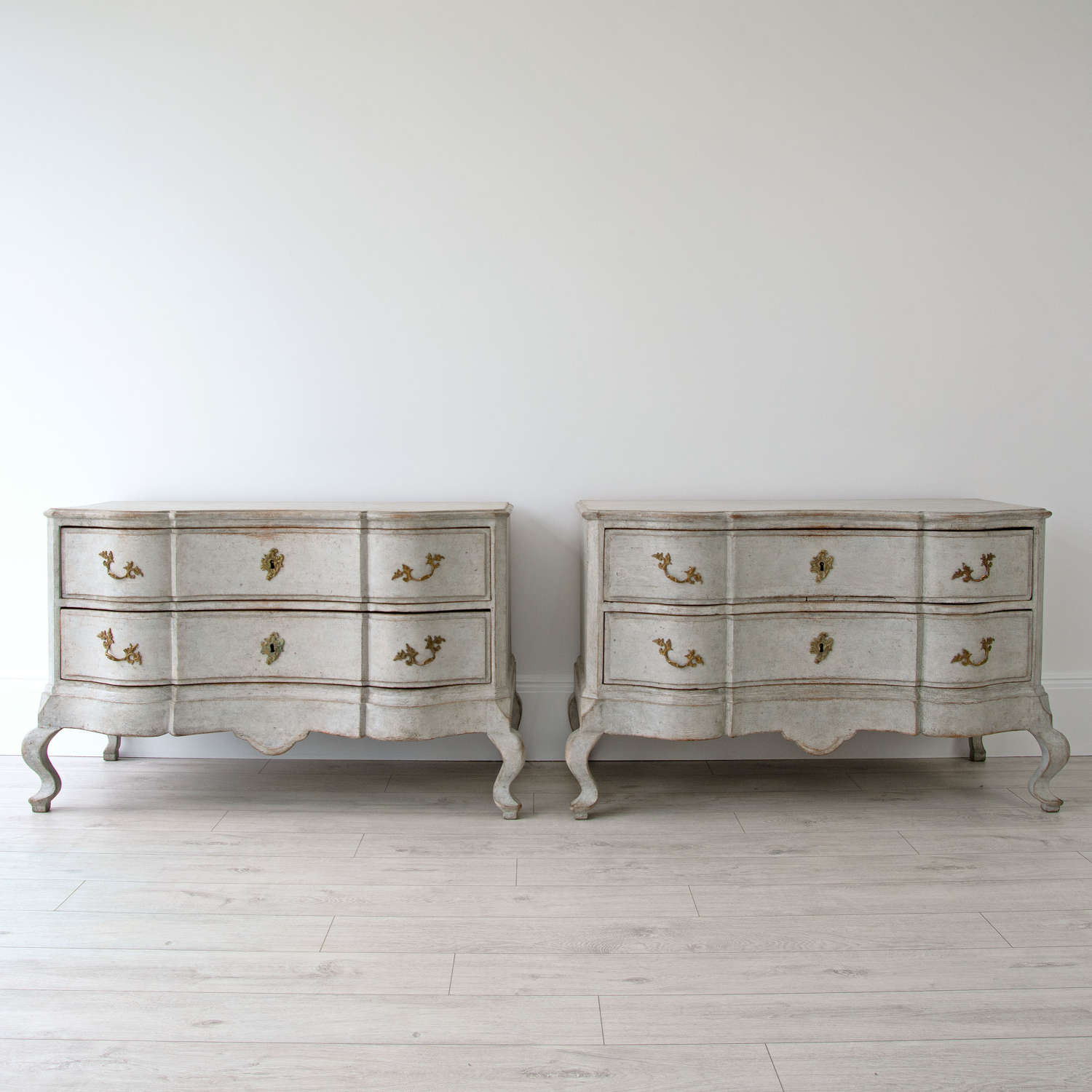 PAIR OF SERPENTINE CHESTS