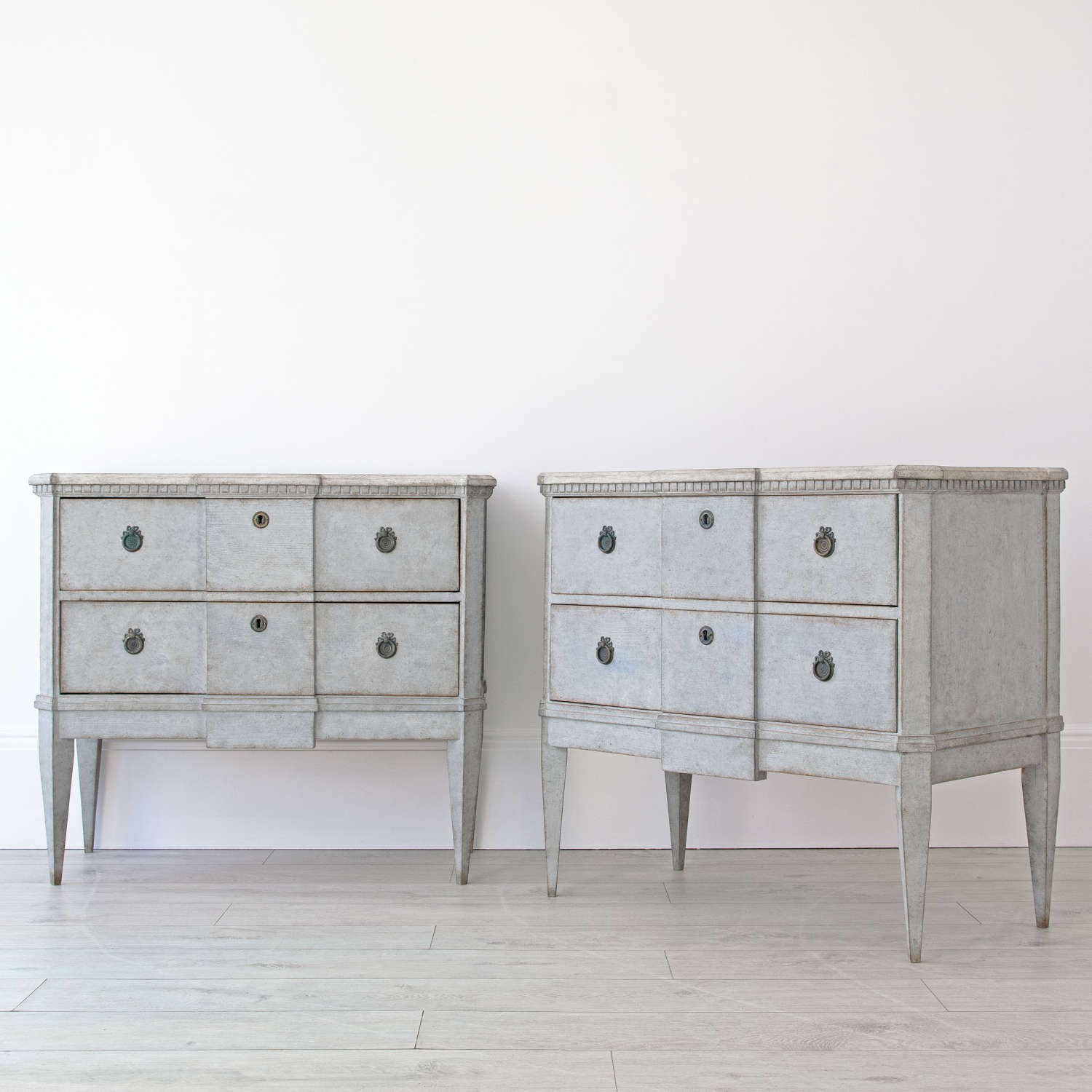 PAIR OF SWEDISH BREAKFRONT CHESTS
